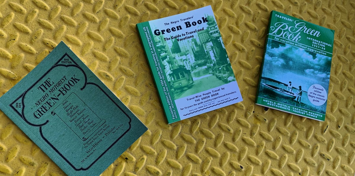 Left-to-right: The 1940, 1956, and 1963-64 facsimile editions of the Green Book (Nakano)