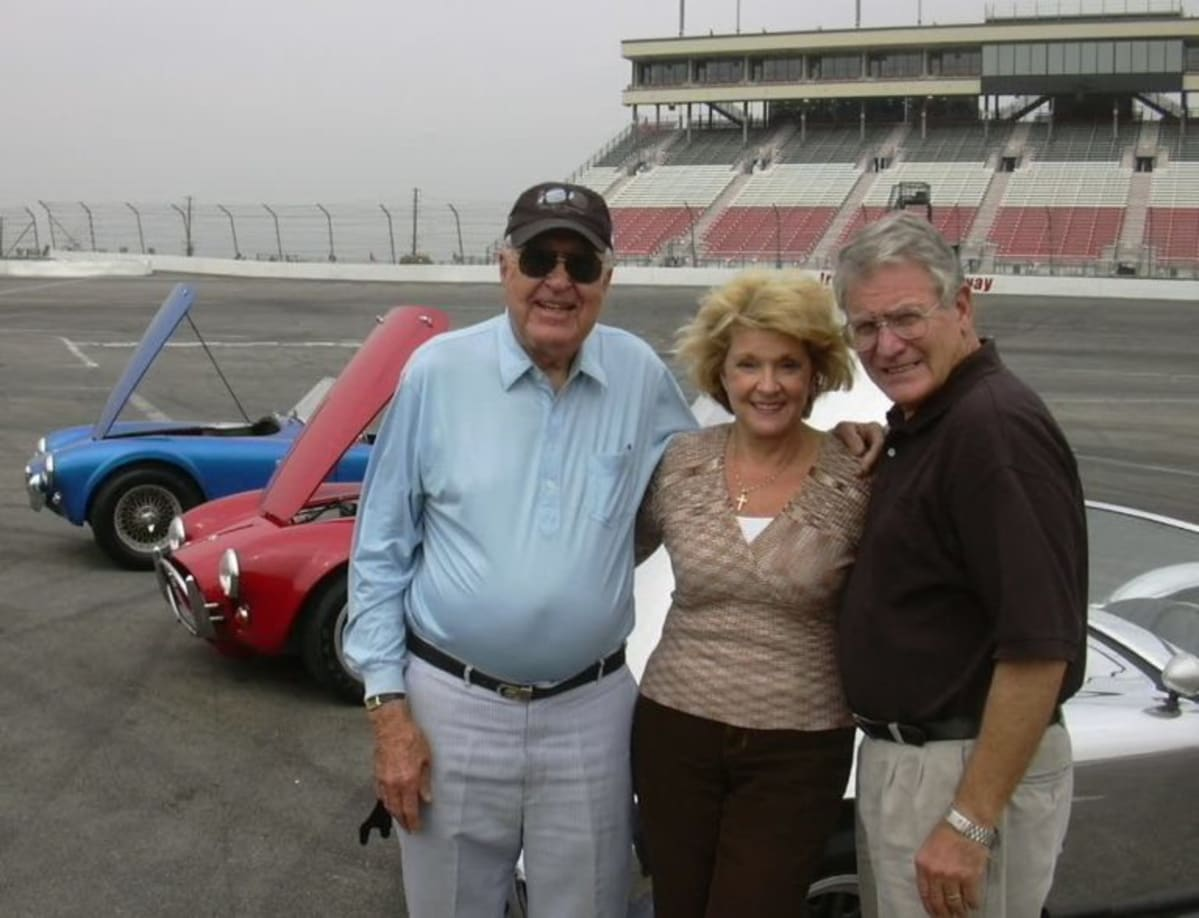 Mister Shelby, Irwindale office manager Marge Peterson, and LACar editor, Stokes … all smiles and vintage Shelby Cobras.
