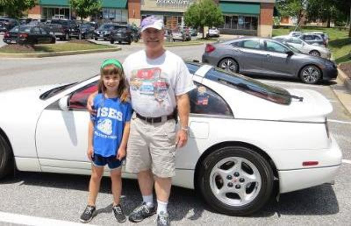 Dan and his daughter Anna with their 300ZX that was the inspiration for the supercomputers article.