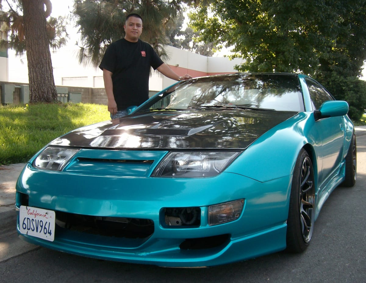 César Diaz from Pomona, CA and his 1991 300ZX. The front bumper comes from a 1999 JDM (Japanese Domestic Model) and TWIN Z provided the over fenders to accommodate the wider wheels and tires.