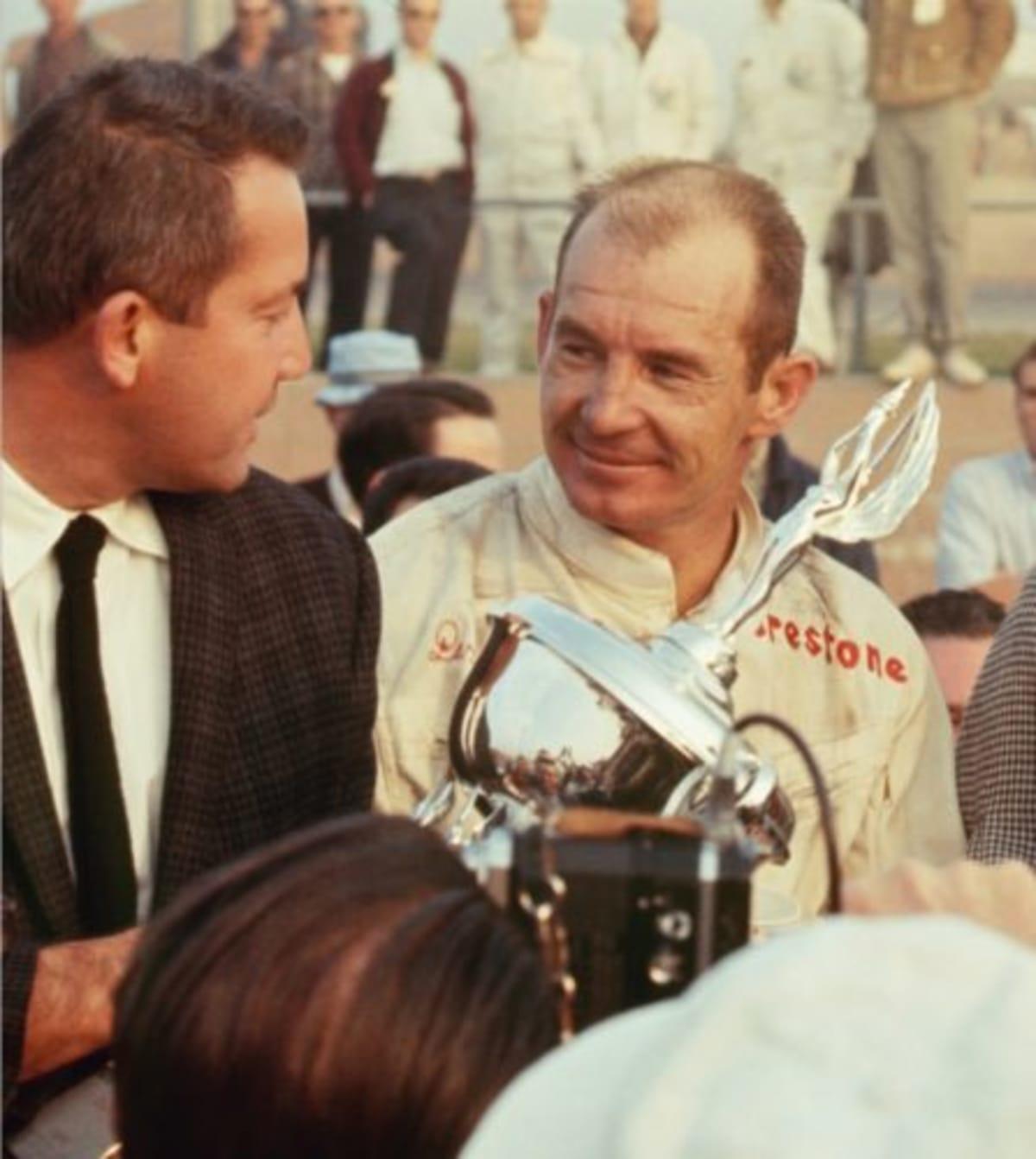 Jones accepts the winner's trophy from race sponsor Robert E Petersen at the 1967 Motor Trend 500 at Riverside International Raceway