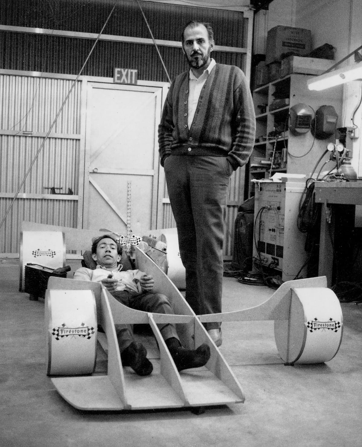 Dare to dream? Dream small … The idea man, Nichols towering over designer Trevor Harris who's crammed into a mock-up of the mysterious Shadow racecar.