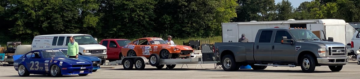 A familiar scene at any race track: towing vehicles, trailers and race cars. zcon