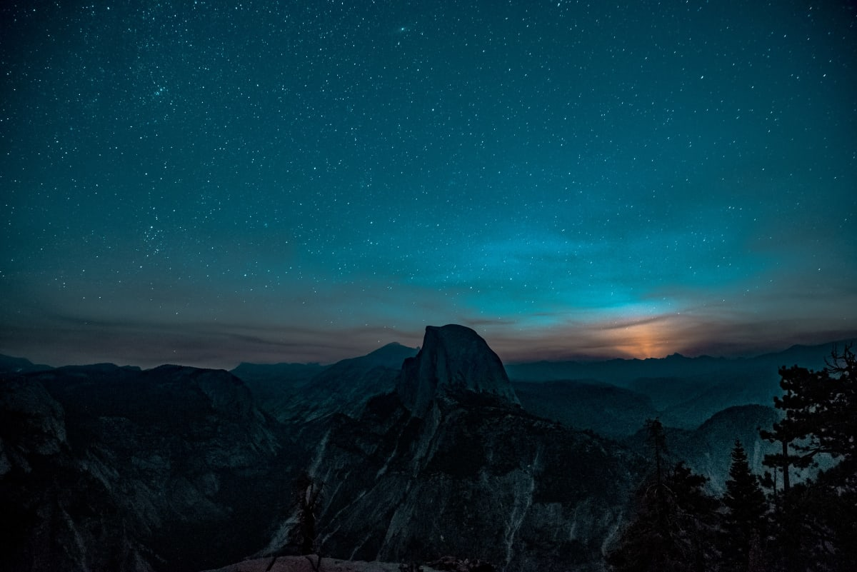 Yosemite National Park. The sun has set behind half-dome and the stars are out in their impressive array.