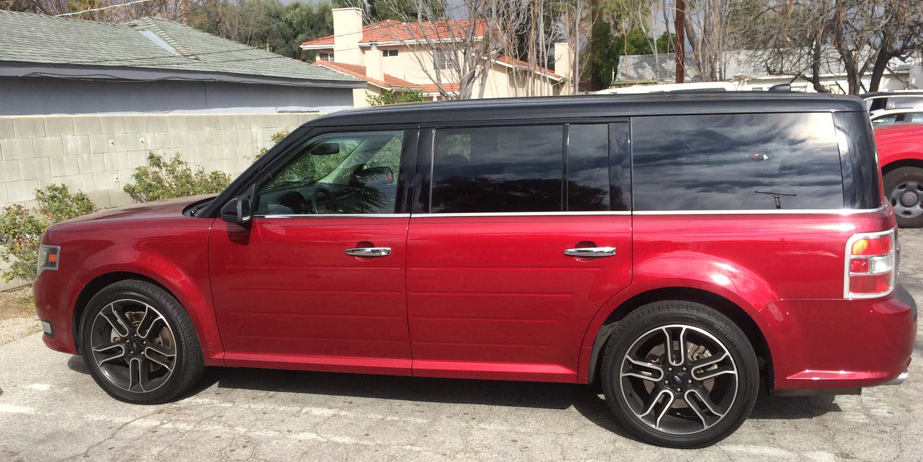 red Ford Flex in Harold's driveway