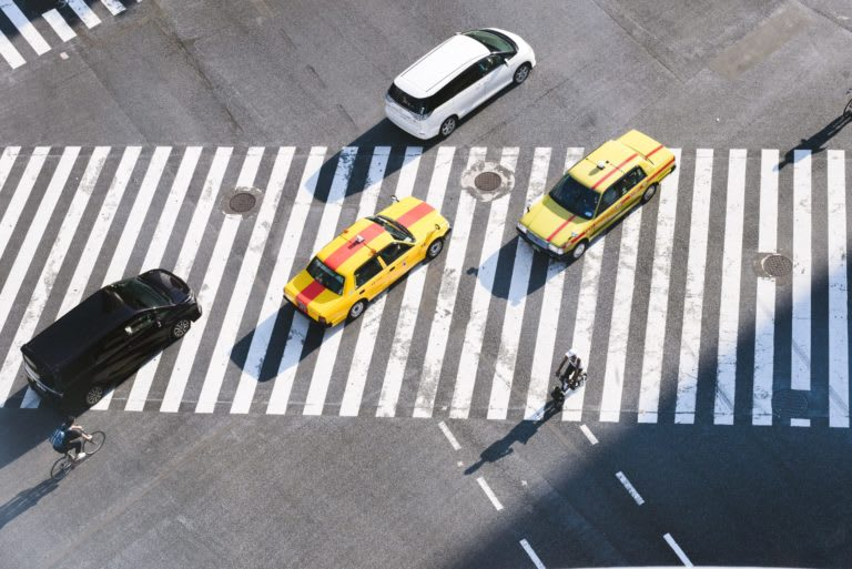 busy intersection with crosswalks in Japan