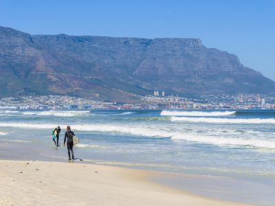 Table Mountain and surfers