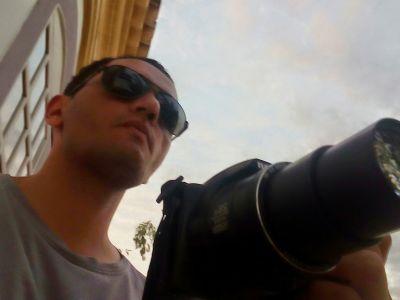 me and my camera. I do your photos.