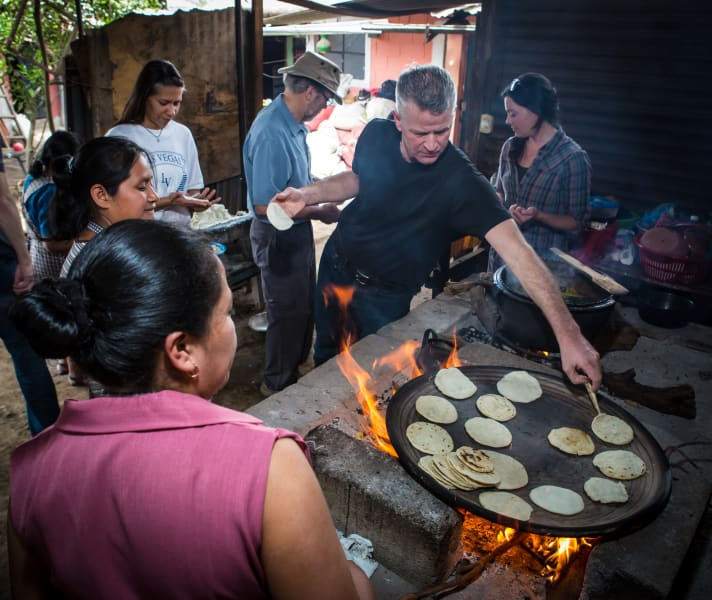 De la Gente Cook pepian and tortillas the traditional way San Miguel Escobar Guatemala Cooking tortillas