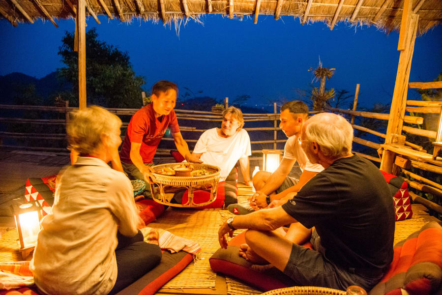 Lisu Lodge Lisu Lodge Trekking and Hill Tribe Village Adventure Chiang Mai Thailand Enjoying a typical northern Thai style dinner