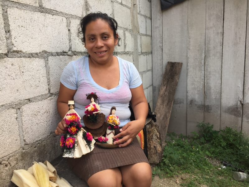 Lokal Adventures Immersive Guatemalan Culture and Nature Adventure Antigua to Peten Guatemala Displaying dolls made from corn husk at Uaxactun.