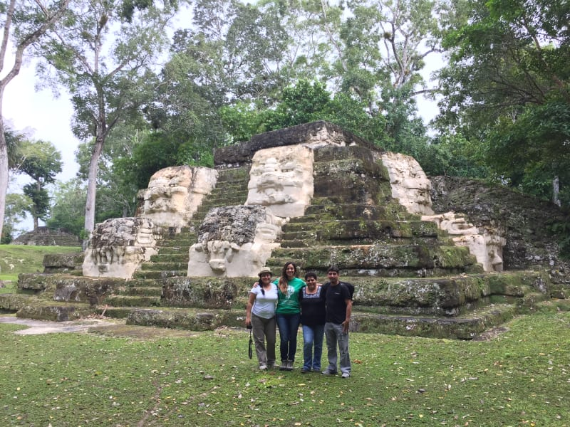 Lokal Adventures Immersive Guatemalan Culture and Nature Adventure Antigua to Peten Guatemala Local guides and community tourism experts at the Uaxactun community ruins
