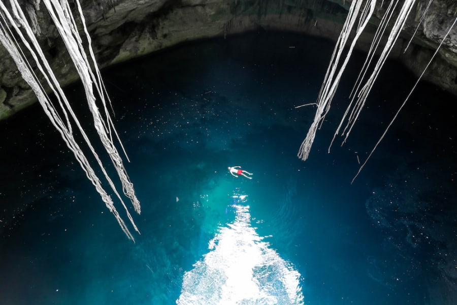 Totonal Viajes Explore Tulum's Nature: Cenotes and Caribbean Biosphere Tulum Mexico Swimming in a cenote