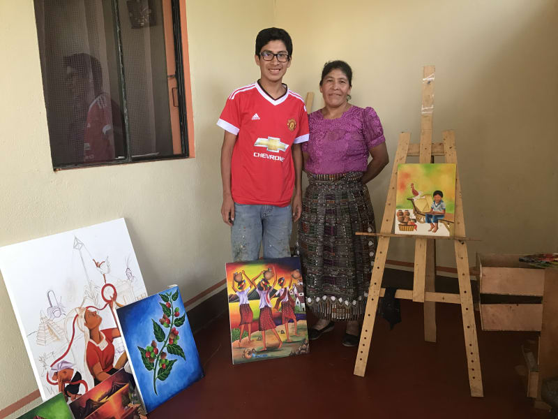 Lokal Adventures Immersive Guatemalan Culture and Nature Adventure Antigua to Peten Guatemala Proud mom next to his son, an aspiring artist. One of your hosts in San Juan la Laguna.