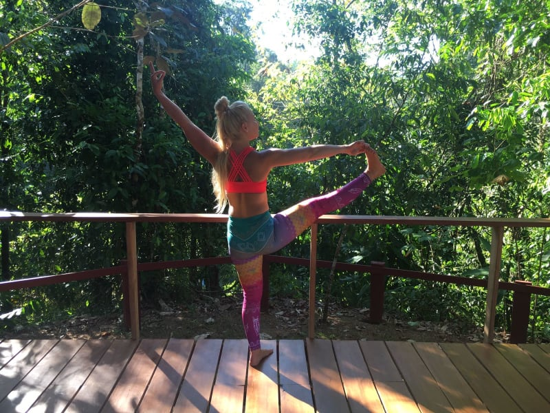 Lokal Adventures Jungle Yoga Adventure Los Planes Costa Rica Inka, our fabulous yoga instructor practicing yoga on the Naguala yoga platform in the middle of the jungle.