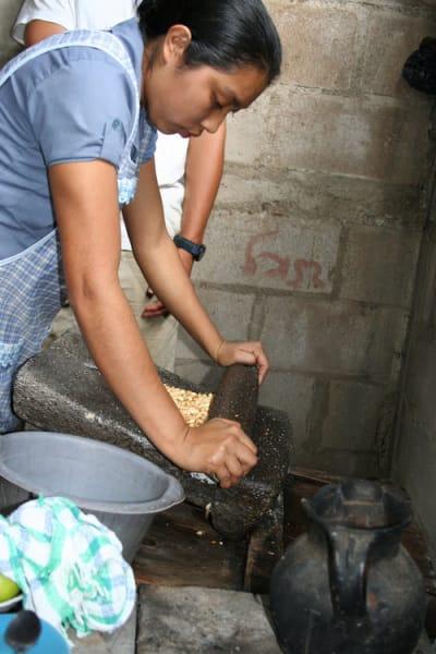 De la Gente Peanut Butter Workshop  San Miguel Escobar Guatemala Lidia grinding peanuts