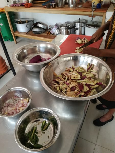 Sthree Cafe Cooking Curries with Local Sri Lankan Women Kandy Sri Lanka Chopping and preparing