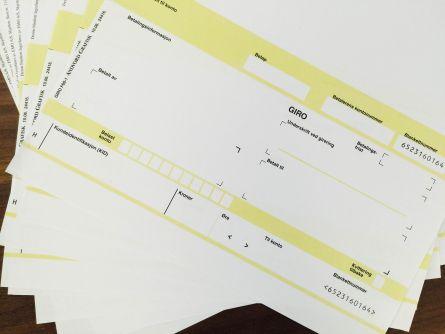 Bilde av fakturaer for å illustrere tjenesten fakturering.