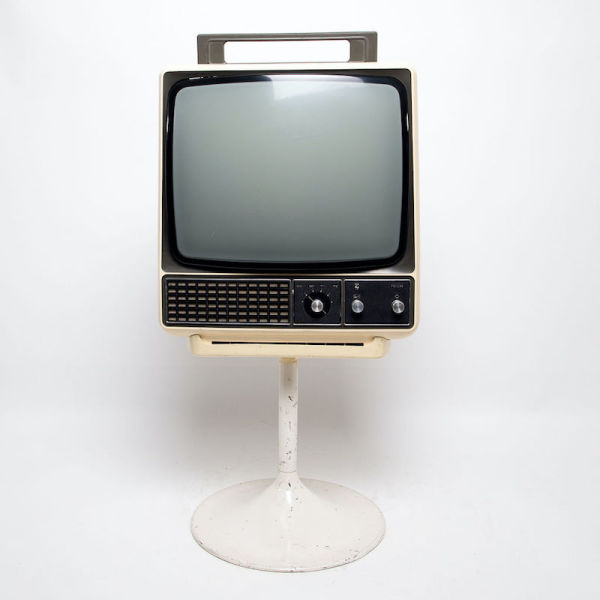 1: Non practical Philips cream retro TV on stand