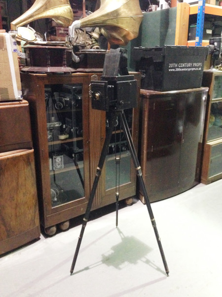 1: Vintage box bellows camera with tripod