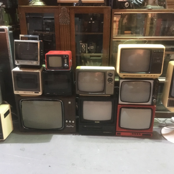 1: Stack of vintage TV's