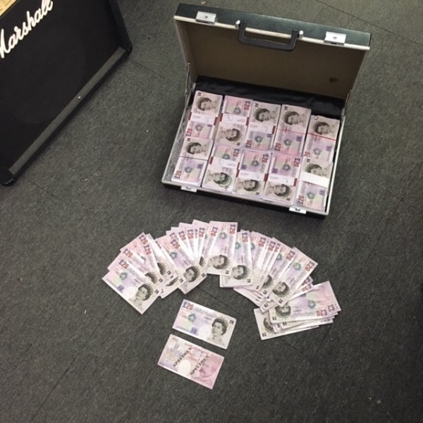 4: Fake money in briefcase - Pounds Sterling