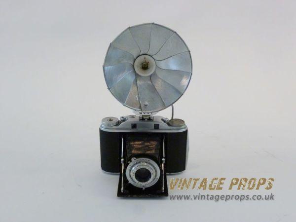 2: Vintage camera with flash reflector