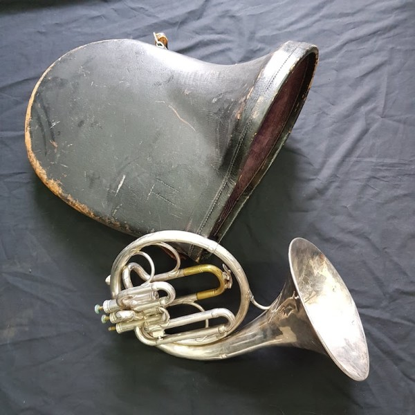 4: French horn with case