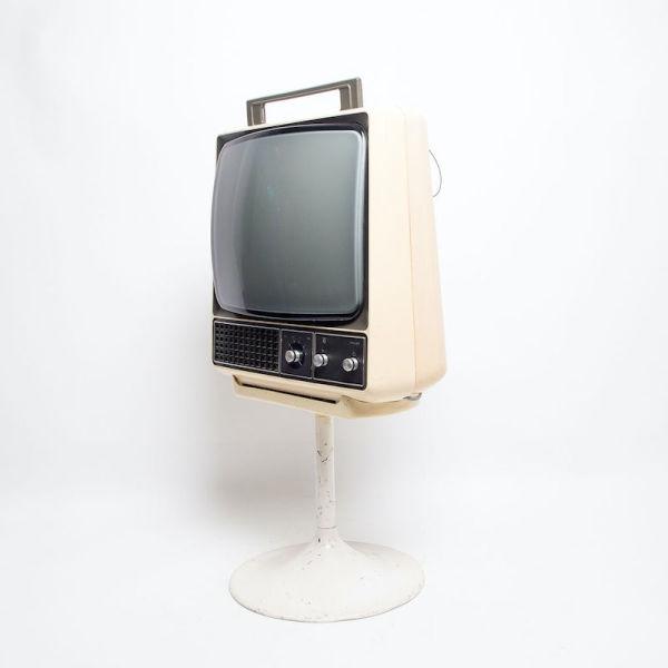 4: Non practical Philips cream retro TV on stand