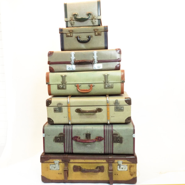 1: Stack of Yellow to Green Coloured Vintage Travel Cases