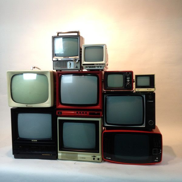 1: Stack of Retro CRT Televisions