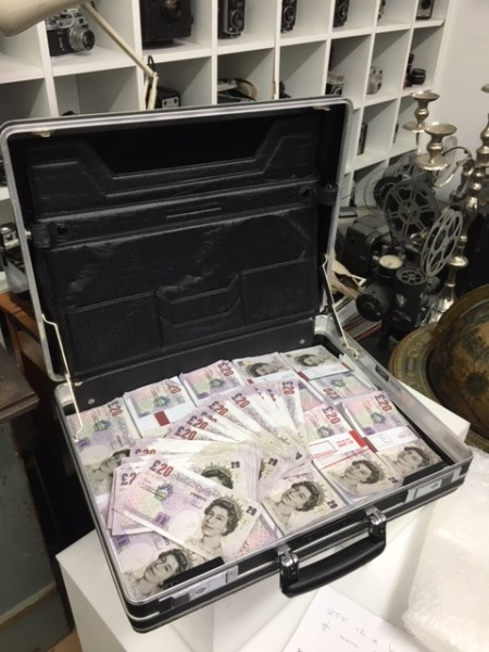 3: Fake money in briefcase - Pounds Sterling