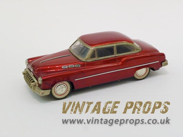 2: Vintage 1950's toy car