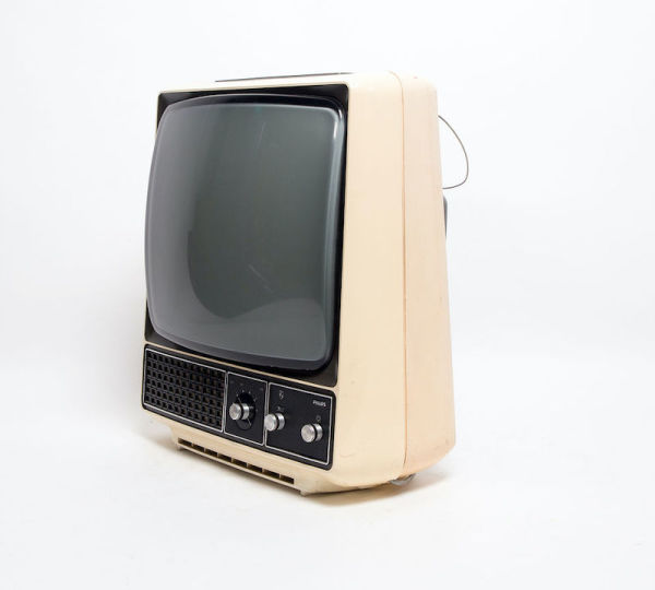 5: Non practical Philips cream retro TV on stand