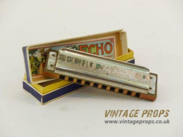 1: Vintage harmonica in box