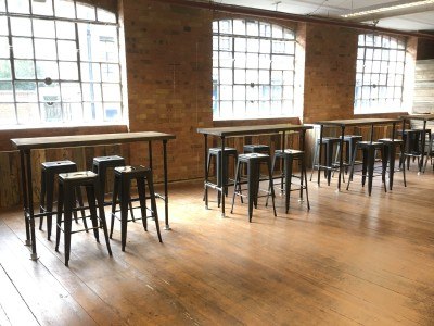 Rustic industrial high poseur tables and metal tolix stools that we supplied to an event in a large warehouse space