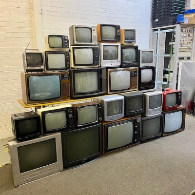 Stack of 26 fully working TV's