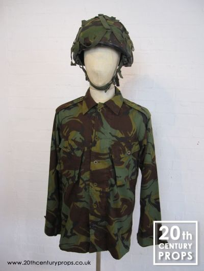 Vintage army shirt & camouflage helmet