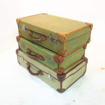 Stack of Green Vintage Canvas Suitcases