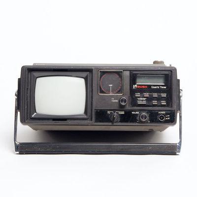 Fully working black Bush Quartz Timer mini portable TV/radio
