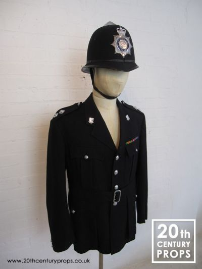 VIntage policemans jacket and helmet