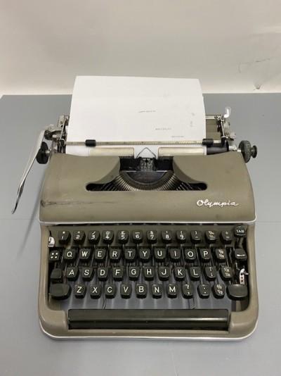 Working green Olympia typewriter