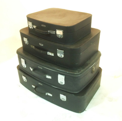 Stack of Matching Black Soft Leather Suitcases
