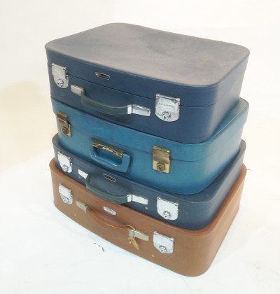 Stack of Different Coloured Retro Soft Leather Suitcases