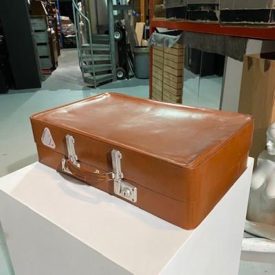 Tan vintage suitcase