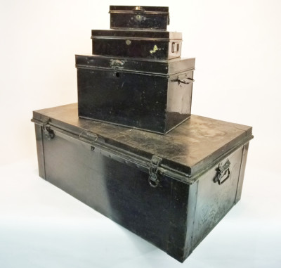 Stack of Black Matching Metal Chests