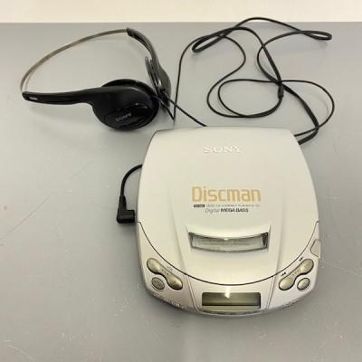 Silver Sony Discman & headphones