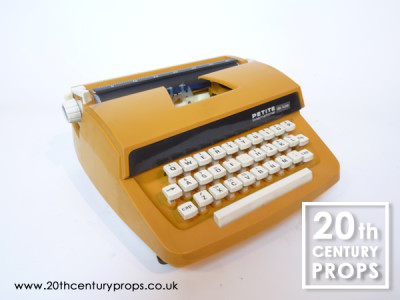 Retro orange typewriter and carry case