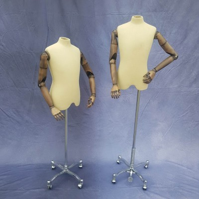 Teenage boy tailors dummy with articulated arms