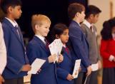 Fairfield children receiving their book of achievements certificates